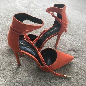 Suede orange heels.